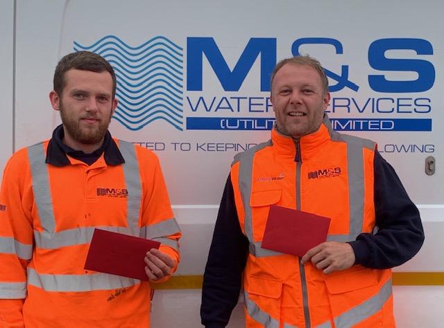 Glen Jones and Alex Campbell were presented an award